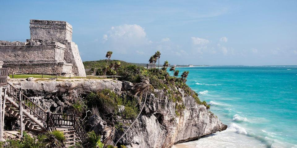 """<p>Mexico's Rivera Maya has a number of Mayan ruins worth exploring, but the only one that's smack-dab on the Caribbean Sea is <a href=""""https://www.tripadvisor.com/Attraction_Review-g150813-d153186-Reviews-Ruins_of_Tulum-Tulum_Yucatan_Peninsula.html"""" rel=""""nofollow noopener"""" target=""""_blank"""" data-ylk=""""slk:Tulum"""" class=""""link rapid-noclick-resp"""">Tulum</a>. Perched high above crystal-clear turquoise waters in a spectacular cliffside setting, the ancient archeological site is home to numerous stone temples, which are decorated with carvings of Mayan gods.</p>"""