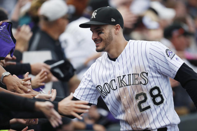 Nolan Arenado set an arbitration record before heading into his walk year. (AP Photo/David Zalubowski)