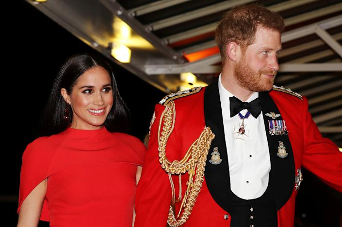 Britain's Prince Harry, Duke of Sussex and Meghan, Duchess of Sussex arrive to attend The Mountbatten Festival of Music at the Royal Albert Hall in London on March 7, 2020. - The Festival brings together world-class musicians, composers and conductors of the Massed Bands of Her Majestys Royal Marines. This year, the performance will mark the 75th anniversary of the end of the Second World War and the 80th anniversary of the formation of Britains Commandos. (Photo by SIMON DAWSON / POOL / AFP) (Photo by SIMON DAWSON/POOL/AFP via Getty Images)