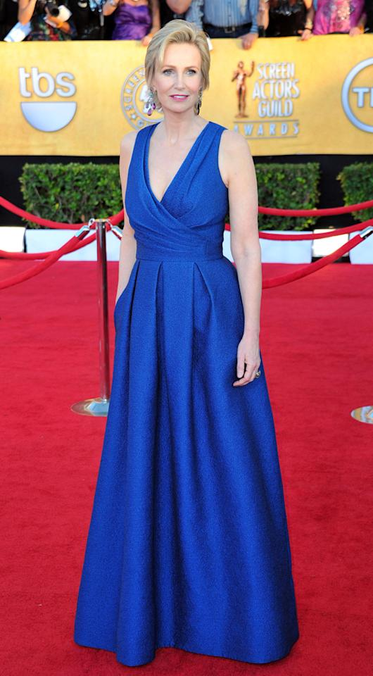 Jane Lynch (in David Meister) arrives at the 18th Annual Screen Actors Guild Awards at The Shrine Auditorium in Los Angeles, California.