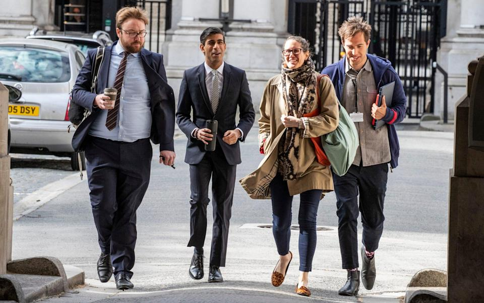 Rishi Sunak arrives at Downing Street with members of his team in May - Heathcliff O'Malley