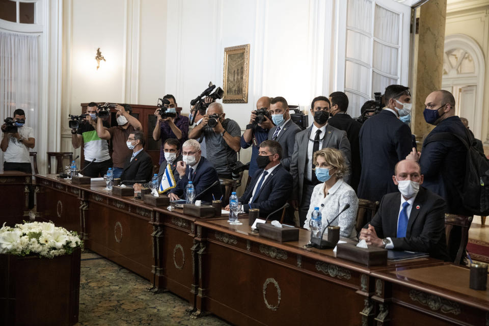 Israeli Foreign Minister Gabi Ashkenazi, third from right, with Egyptian Foreign Minister Sameh Shoukry (not shown), during high-level talks to shore up a fragile truce between Israel and the Hamas militant group at the Tahrir Palace in Cairo, Egypt, Sunday, May 30, 2021. (AP Photo/Nariman El-Mofty)