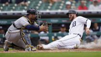 Detroit Tigers' Robbie Grossman, right, slides safely into home plate to score as Milwaukee Brewers catcher Omar Narvaez waits for the throw in the fourth inning of a baseball game in Detroit, Wednesday, Sept. 15, 2021. (AP Photo/Paul Sancya)