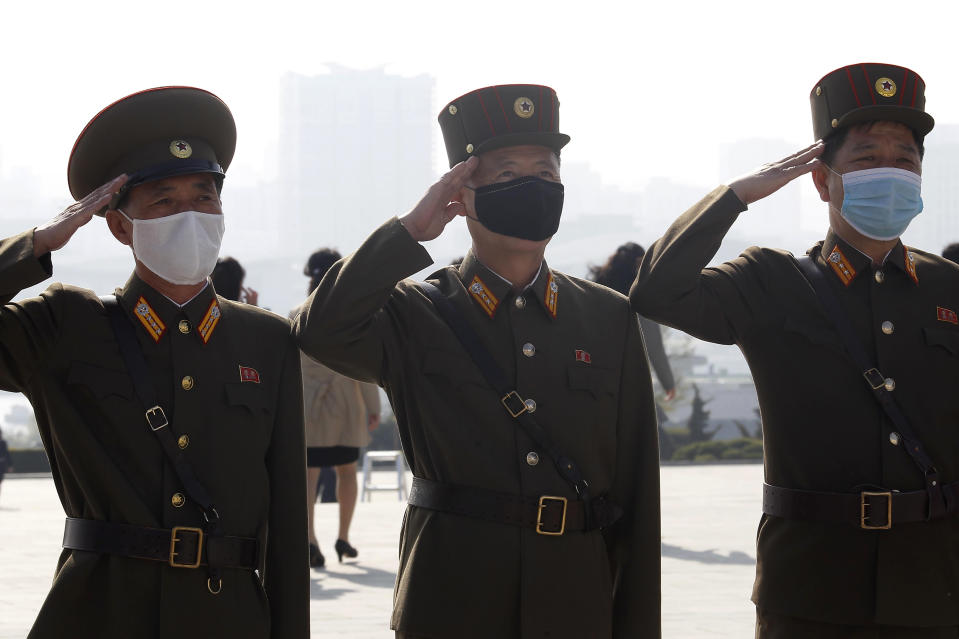 North Korean army officers visit the Mansu Hill on the occasion of the Day of the Sun, the birth anniversary of late leader Kim Il Sung, in Pyongyang, North Korea Thursday, April 15, 2021. (AP Photo/Cha Song Ho)