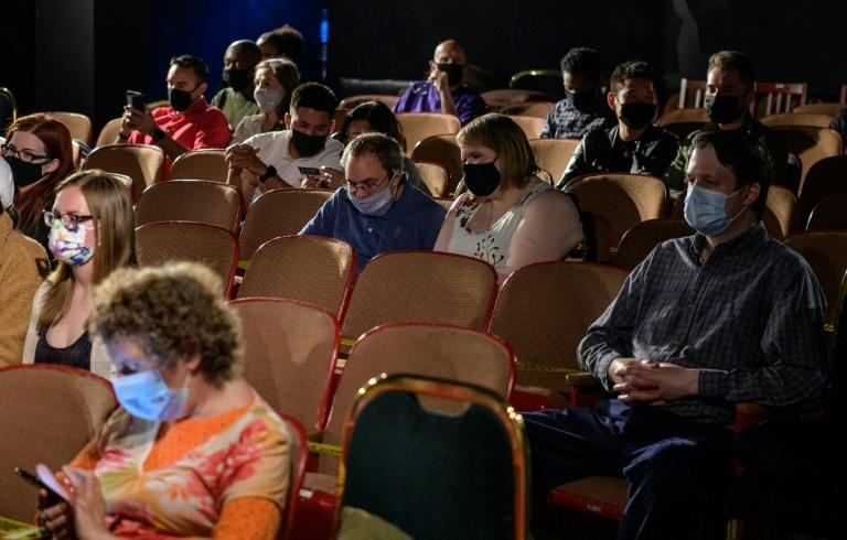 """The audience watching the reopening of """"Perfect Crime"""" at Theater Center in New York, April 27"""