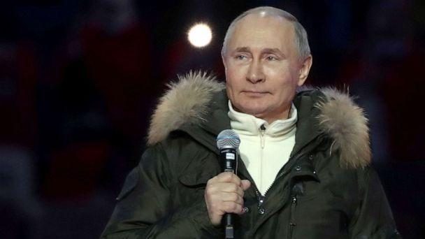 PHOTO: Russian President Vladimir Putin attends a concert marking the seventh anniversary of Russia's annexation of Crimea at Luzhniki Stadium in Moscow, March 18, 2021. (Sputnik via Reuters)