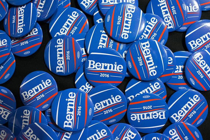 Buttons sit on a table during a campaign event for Sen. Bernie Sanders at Drake University on June 12, 2015 in Des Moines, Iowa.