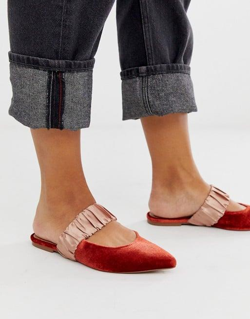 "<p>How chic are these <a href=""https://www.popsugar.com/buy/ASOS-DESIGN-Velvet-Mules-521284?p_name=ASOS%20DESIGN%20Velvet%20Mules&retailer=asos.com&pid=521284&price=26&evar1=fab%3Aus&evar9=45530840&evar98=https%3A%2F%2Fwww.popsugar.com%2Ffashion%2Fphoto-gallery%2F45530840%2Fimage%2F46928662%2FASOS-DESIGN-Velvet-Mules&list1=shopping%2Cshoes%2Cflats%2Choliday%2Cgift%20guide%2Cnew%20years%20eve%2Choliday%20fashion&prop13=api&pdata=1"" rel=""nofollow"" data-shoppable-link=""1"" target=""_blank"" class=""ga-track"" data-ga-category=""Related"" data-ga-label=""https://www.asos.com/us/asos-design/asos-design-lately-pointed-mules-in-rust-velvet/prd/12627598?clr=rust-velvet&amp;colourWayId=16465281&amp;SearchQuery=&amp;cid=6459"" data-ga-action=""In-Line Links"">ASOS DESIGN Velvet Mules</a> ($26, originally $32)?</p>"