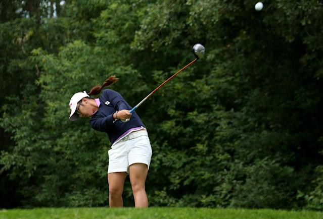 EDMONTON, AB - AUGUST 25: Lydia Ko of New Zealand hits her tee shot on the fifth hole during the final round of the CN Canadian Women's Open at Royal Mayfair Golf Club on August 25, 2013 in Edmonton, Alberta, Canada. (Photo by Stephen Dunn/Getty Images)