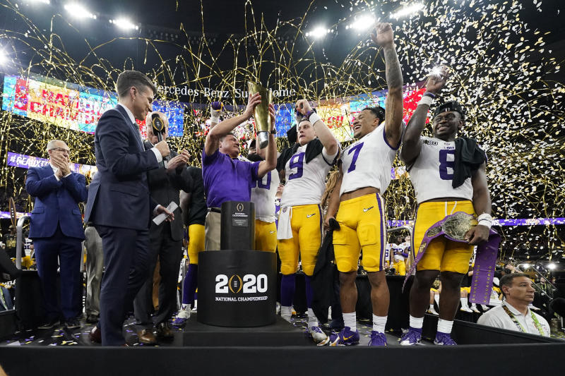 LSU head coach Ed Orgeron holds the trophy after their win against Clemson in a NCAA College Football Playoff national championship game Monday, Jan. 13, 2020, in New Orleans. LSU won 42-25.(AP Photo/David J. Phillip)