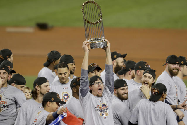The Astros celebrate with the trophy after their World Series triumph over the Dodgers in Game 7. (AP)