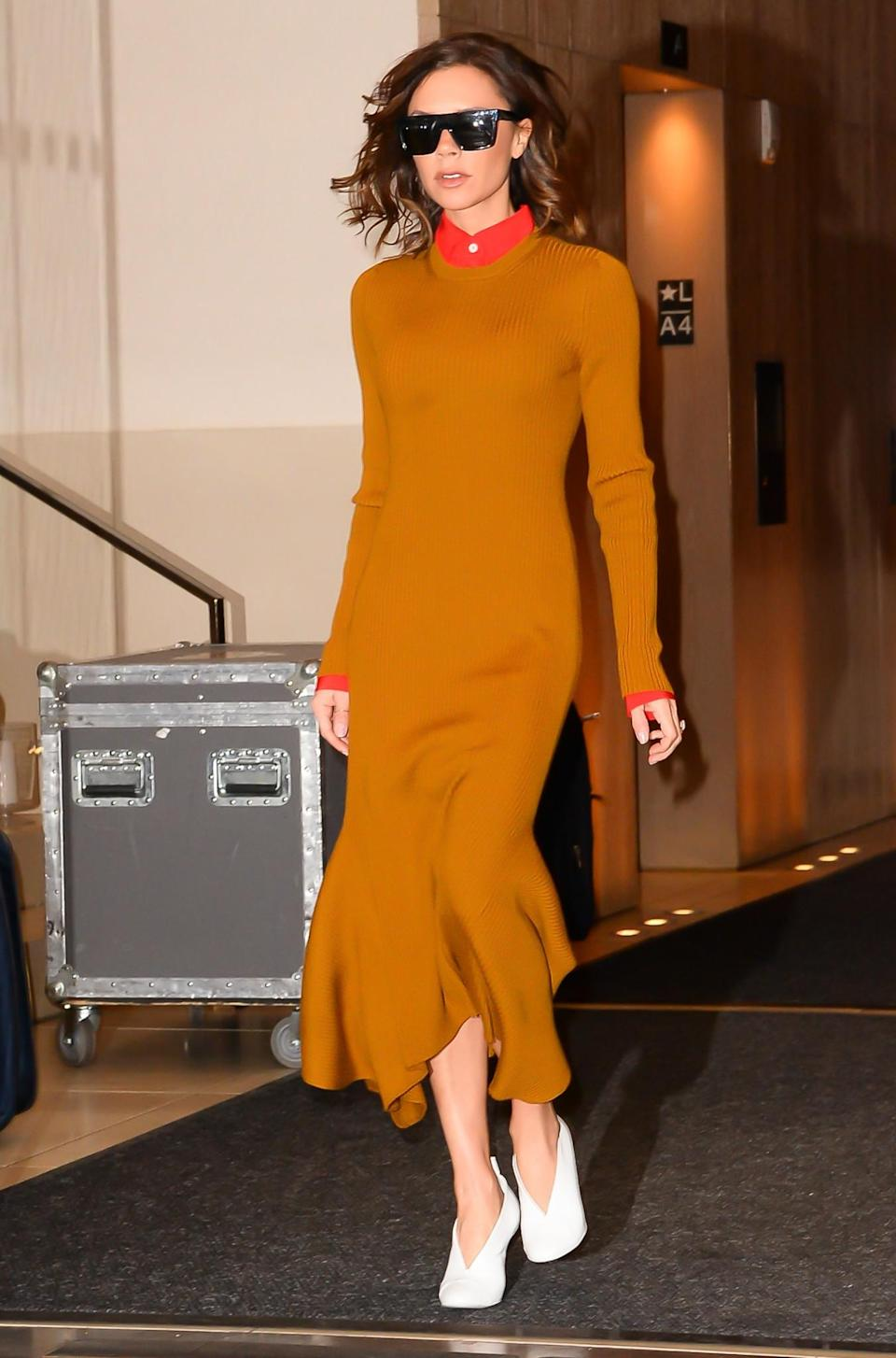 <p>Bang on trend – as always – in a mustard knit dress, this look was a winning ensemble for the designer. <em>[Photo: Getty]</em> </p>