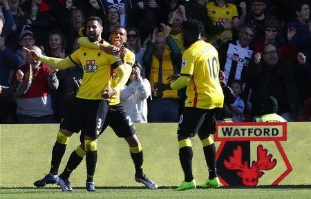 Watford's Miguel Britos celebrates scoring their first goal with Watford's Etienne Capoue and Watford's Isaac Success