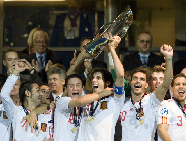 Spanish players celebrate with the trophy at the end of the UEFA Under-21 European Championship final football match Spain vs Switzerland at the Aarhus Stadium, on June 25, 2011. Spain won the final with 2-0.AFP PHOTO/JONATHAN NACKSTRAND (Photo credit should read JONATHAN NACKSTRAND/AFP/Getty Images)
