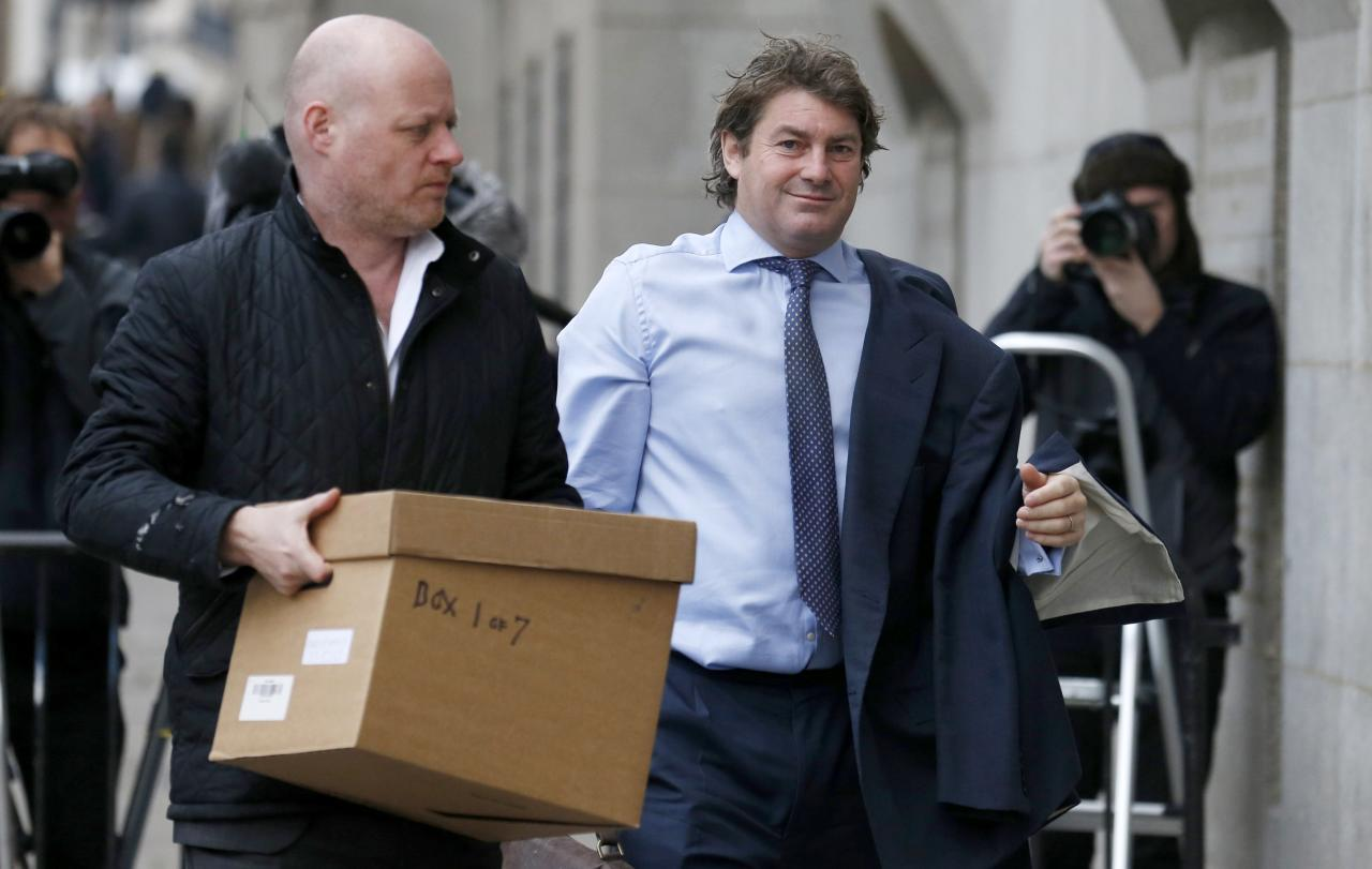 Charlie Brooks, the husband of former News International chief executive Rebekah Brooks, arrives at the Old Bailey courthouse in central London December 10, 2013. REUTERS/Suzanne Plunkett (BRITAIN - Tags: MEDIA CRIME LAW SOCIETY)
