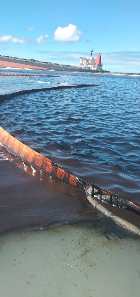 "This photo taken and provided by Georges de La Tremoille of Mu Press shows a containment boom collecting oil leaking from the MV Wakashio, a bulk carrier ship that recently ran aground off the southeast coast of Mauritius, Friday, Aug. 7, 2020. The Indian Ocean island of Mauritius declared a ""state of environmental emergency"" late Friday after a Japanese-owned ship that ran aground offshore days ago began spilling tons of fuel. (Georges de La Tremoille/MU Press via AP)"