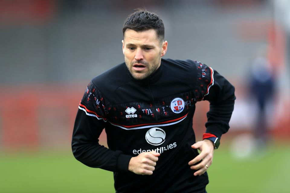 Crawley Town's Mark Wright warms up prior to during the Emirates FA Cup third round match at the People's Pension Stadium, Crawley.
