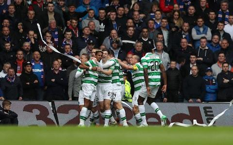 "As Celtic moved five points ahead of Rangers prior to the first Old Firm derby of the season at Ibrox, Brendan Rodgers branded next Saturday's game a contest between title contenders, despite the gap that has already opened between the pair in the table. Rangers had to come from behind to earn a point in the 2-2 draw with Partick Thistle at Firhill on Friday and could not prevail despite playing against 10 men for the final quarter of the proceedings. Indeed, Pedro Caixinha's players will go into their collision with the champions in third place after Saturday's results in the Scottish Premiership. Nevertheless, the Hoops manager cited the difference in summer transfer fees – Rangers' outlay was an estimated £8 million, compared with Celtic's £5.5 million, although the figures are arguable – as evidence that the Ibrox board were aiming to prise the Scottish title from the other side of Glasgow. ""I've seen a little bit of Rangers,"" Rodgers said. ""Pedro obviously came in during the season and was able to assess and look at different methods in which they can try to work and play. Humbled: Neymar and company gave Celtic a harsh lesson midweek Credit: AFP ""They have clearly spent money in the summer. They spent more money than us – and we are a Champions League club - so that tells you that their idea is to win the league. It's not to finish third. Not to finish second above Aberdeen. It's to win the league. ""They have come into the season with that mentality. They have signed some good players and are playing a basic shape in terms of 4-4-2, nothing complicated, get the ball wide, crosses in the box. I'm sure they will be reasonably happy with how they have started."" Celtic's 5-1 victory at Ibrox was widely viewed as a tactical blunder by Caixinha, who chose to deploy Rangers with a midfield diamond, through which the champions romped to establish a record victory on the ground of their arch-foes. Rodgers, though, declared that the Rangers line-up had not been novel in the circumstances, despite Caixinha's adoption of 4-4-2 this season. Keep smiling: Pedro Caixinha arrives for the Scottish Premiership match at The Energy Check Stadium at Firhill Credit: PA ""A lot of the European coaches will have different ways. I'm not sure 4-4-2 is what Pedro would purely like to play,"" he said. ""I think he is looking at what he's got and how he can maximise what he gets from the players. ""They played with a diamond, looking to have numbers in midfield and two front players. It's flatter now in terms of how they are playing it, but their intention, I'm sure, is to win the league and what they have spent is a mark of that."" The Celtic boss, however, acknowledged that – having beaten Rangers in the William Hill Scottish Cup semi-final a week previously, the 5-1 rout had capped a deeply satisfying passage. ""It was great week,"" he said. ""We went into the semi-final and were outstanding – our performance level in every facet was very good. At Ibrox the feeling was that we would be under severe pressure from their play and the crowd and there was no way we could go and play like we did in the semi. ""For the players to go out and handle that side of it and perform like they did and actually be disappointed we only scored five made the performance outstanding."" April, the cruellest month: Celtic won 5-1 on their last visit to Ibrox Credit: Reuters So dominant were Celtic last time out at Ibrox that the home support began to make for the exits midway through the second half. ""For every manager and player, it is feeling that you are working well. You are doing your job if the game is over by 65, 70 minutes,"" Rodgers said. ""In a 90-minute game you can take huge credit for how you are playing at that stage. If you are going to Ibrox and doing that against one of the great rivals and performing at that level, which was key for me, it was pretty special."" Celtic, of course, conceded five goals in their midweek Champions League group stage opener at home to Paris Saint-Germain but normal service was resumed with the visit of Ross County, who found themselves behind to a Tom Rogic strike after 13 minutes. The Staggies fell further behind five minutes before the break when Moussa Dembele, on his first appearance this season, placed a low right foot drive into the far corner of the net. The restart brought no relief for County as Celtic hit them on the counter from a memorable double save by Craig Gordon from Craig Curran and Alex Schalk. James Forrest netted on the rebound from a Rogic effort and scored Celtic's fourth and his second after Oddsone Edouard's prompt. Elsewhere, Aberdeen were held 1-1 at home to Kilmarnock, Hearts' first victory under Craig Levein was a 2-1 win at Hamilton, while Hibs drew 2-2 with Motherwell at Easter Road and Dundee were 3-2 winners against Tayside neighbours, St Johnstone."