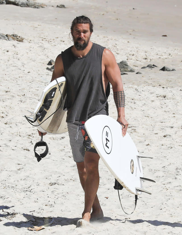<p>Down in Australia, where he's filming <i>Aquaman</i>, Momoa spent his day off hanging on the beach with friends and some sweet waves. (Photo: Media-Mode/Splash News) </p>
