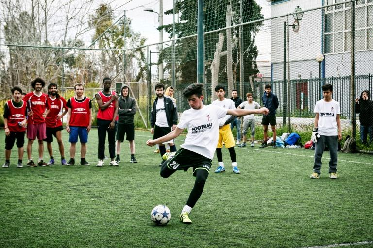 Going for goal: Jawad Ahmadi takes a penalty kick during a tournament with teams composed of refugees and European volunteers in Athens