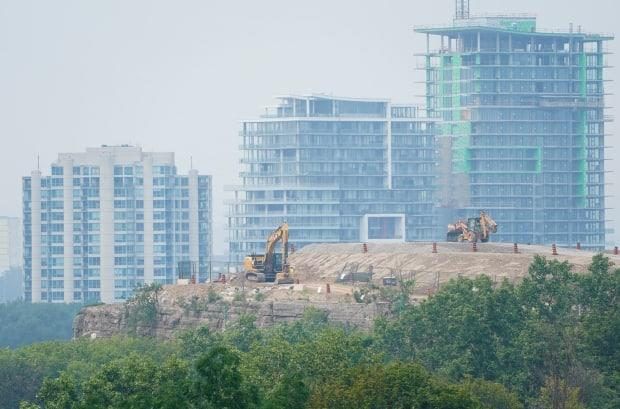 The city of Gatineau, Que., is shrouded in smoke from wildfires as construction machinery work at Nepean Point in Ottawa July 19, 2021. (Sean Kilpatrick/The Canadian Press - image credit)