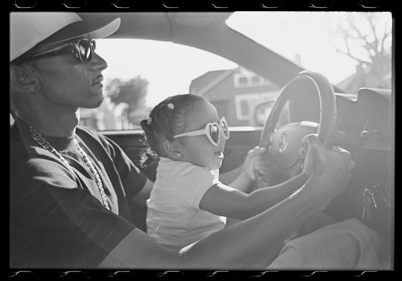 Nipsey and his daughter, Emani, driving down 60th Street, 2010.