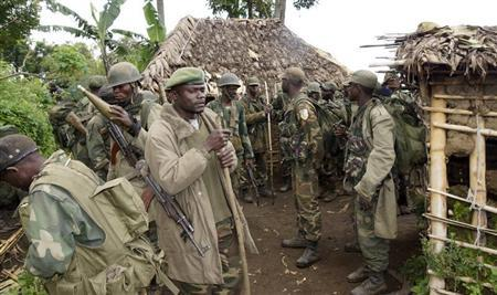 Congolese soldiers gather for a military brief after M23 rebel fighters surrendered in Chanzo village in the Rutshuru territory near the eastern town of Goma