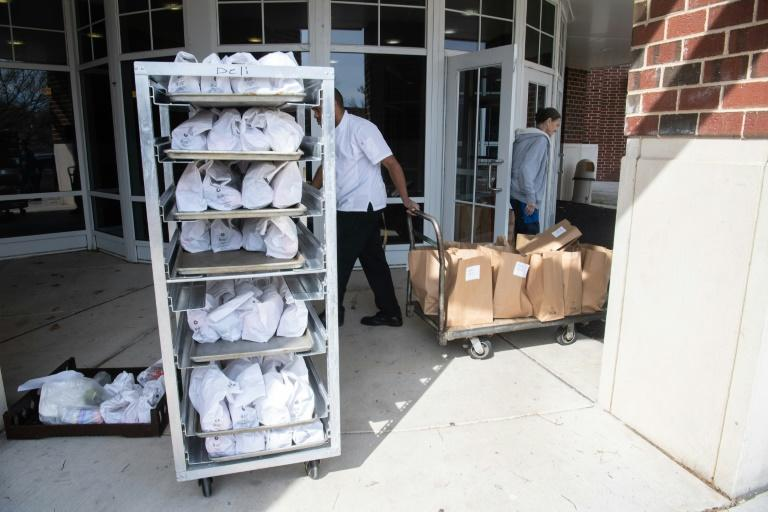 Bags filled with breakfasts and lunches for distribution to students locked out of school in Alexandria, Virginia, because of the coronavirus