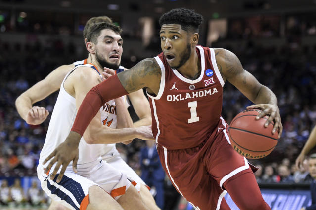 Oklahoma guard Rashard Odomes (1) drives past Virginia guard Ty Jerome (11) during the first half of a second-round game in the NCAA men's college basketball tournament Sunday, March 24, 2019, in Columbia, S.C. (AP Photo/Sean Rayford)