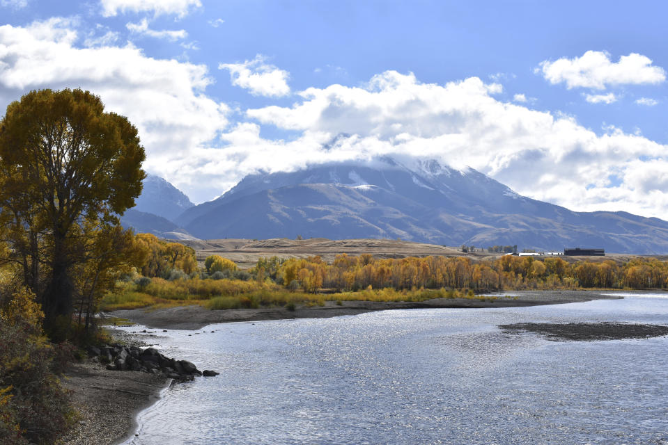 FILE - In this Oct. 8, 2018, file photo, Emigrant Peak is seen rising above the Paradise Valley and the Yellowstone River near Emigrant, Mont. A senate panel deadlocked Thursday, July 22, 2021, on the Biden administration's nominee Tracy Stone-Manning to oversee roughly 250 million acres of public lands as director of the U.S. Bureau of Land Management. (AP Photo/Matthew Brown, File)
