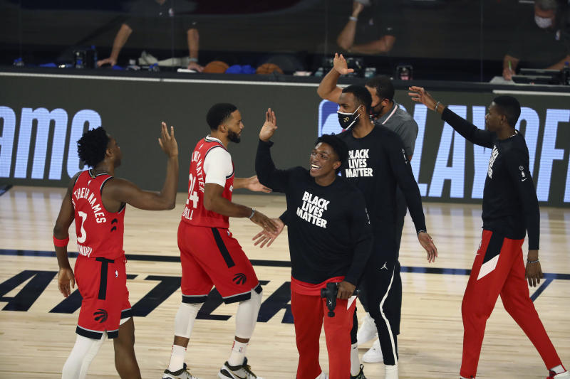 Toronto Raptors players high five after sweeping the Nets.