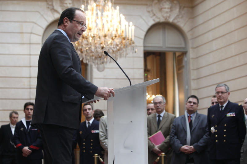 """France's President Francois Hollande gives a speech during a ceremony to honor French troops home from Afghanistan, at the Elysee Palace, in Paris, Friday, Dec. 21, 2012. Hollande has declared """"mission accomplished"""" for French combat troops who returned home recently from Afghanistan. France still has 1,500 troops in Afghanistan repatriating equipment or working in roles like providing medical care or helping run Kabul's airport. Hollande said the numbers will decline to 500 by mid-2013. (AP Photo/Thibault Camus, Pool)"""