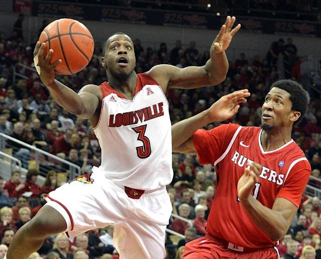 Louisville's Chris Jones, left, drives past the defense of Rutgers' Kadeem Jack to attempt a layup during the second half of an NCAA college basketball game Sunday, Feb. 16, 2014, in Louisville, Ky. Louisville won 102-54. (AP Photo/Timothy D. Easley)