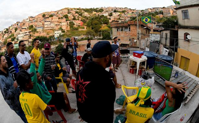 Fans watch the broadcast of the World Cup Group E soccer match between Brazil and Switzerland, at Aglomerado da Serra slum in Belo Horizonte, Brazil June 17, 2018. REUTERS/Washington Alves