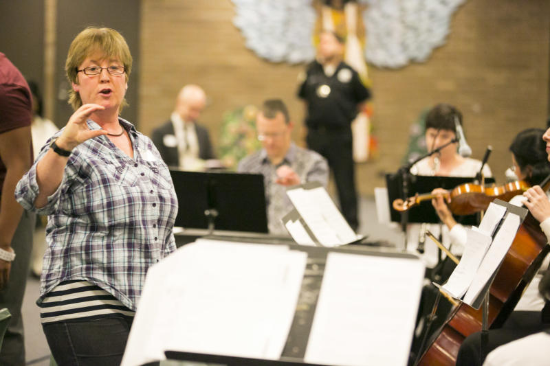 Music in Prisons Artistic Director Sara Lee leads a group of Chicago Symphony Orchestra musicians and inmates at the Cook County Juvenile Detention Center in a performance for friends and families of inmates, Sunday, April 14, 2013. (AP Photo/Todd Rosenberg)