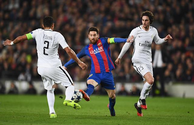 <p>Lionel Messi of Barcelona takes on Thiago Silva (2) and Adrien Rabiot of PSG (25) during the UEFA Champions League Round of 16 second leg match between FC Barcelona and Paris Saint-Germain at Camp Nou on March 8, 2017 in Barcelona, Spain. (Photo by Laurence Griffiths/Getty Images) </p>