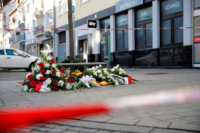 Flowers are placed at a makeshift memorial for the victims of the Hanau shooting: AFP via Getty Images
