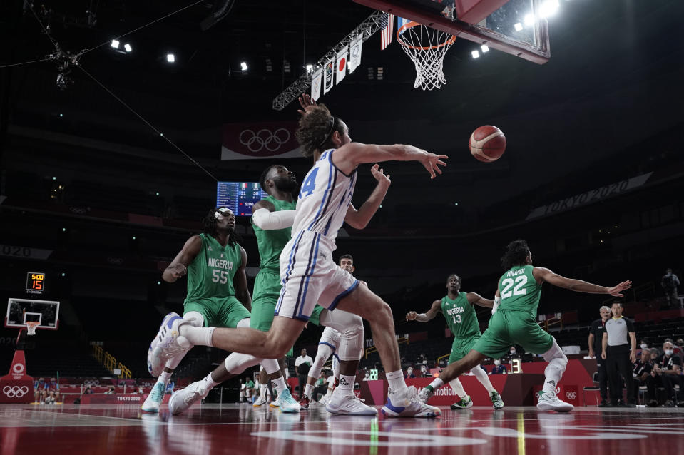 Italy's Alessandro Pajola (54), center, passes the ball during men's basketball preliminary round game against Nigeria at the 2020 Summer Olympics, Saturday, July 31, 2021, in Saitama, Japan. (AP Photo/Eric Gay)
