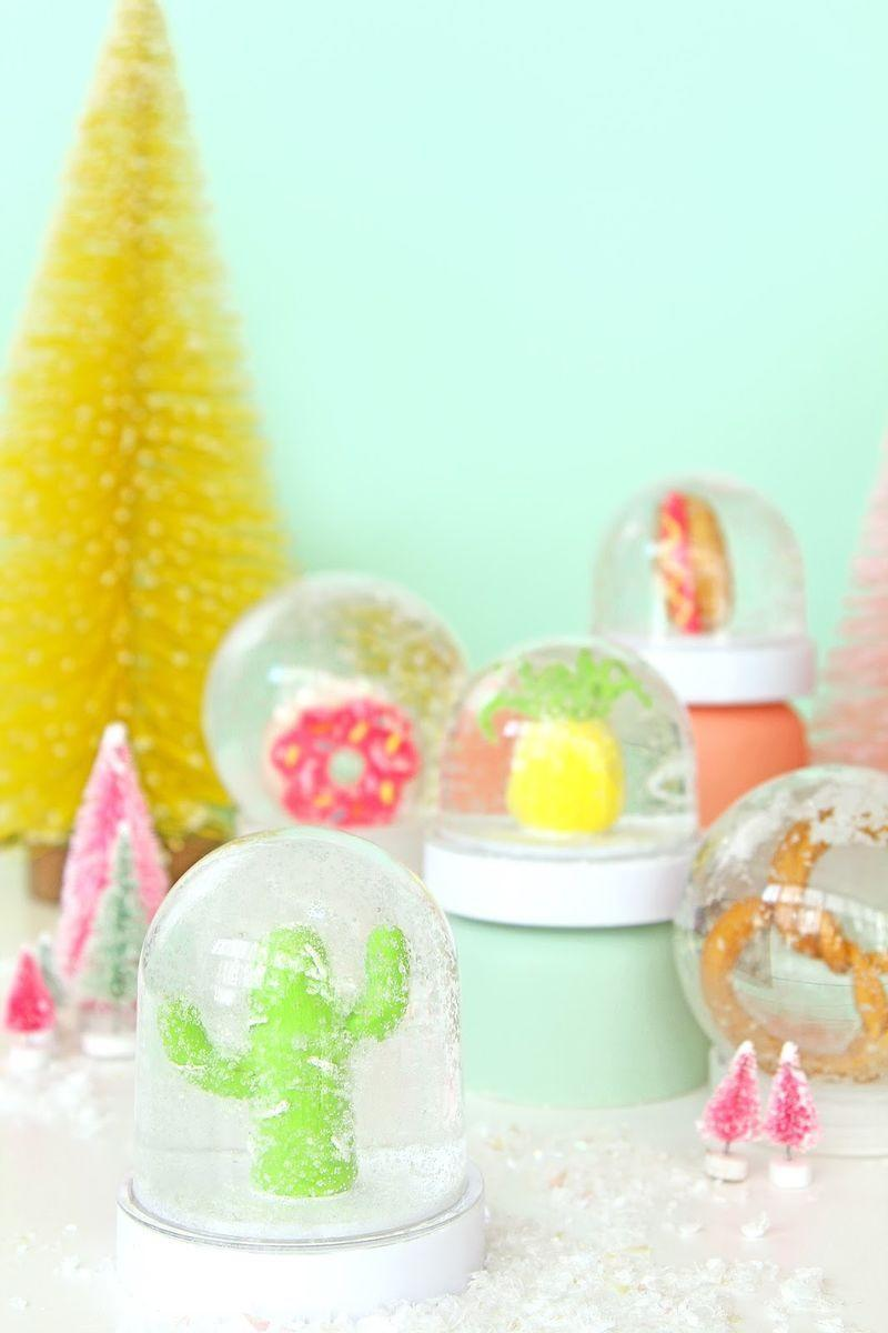 """<p>Love Christmas, but not red and green? Then make this whimsical snow globe filled with cute, little sculpted figurines you make yourself from oven-bake clay.</p><p><strong><strong>Get the tutorial a</strong>t <a href=""""http://www.awwsam.com/2015/12/diy-fun-novelty-snow-globes.html"""" rel=""""nofollow noopener"""" target=""""_blank"""" data-ylk=""""slk:Aww Sam"""" class=""""link rapid-noclick-resp"""">Aww Sam</a>.</strong></p><p><a class=""""link rapid-noclick-resp"""" href=""""https://www.amazon.com/Polyform-Sculpey-Clay-Mold-Classics/dp/B0055E871A/ref=dp_fod_2?pd_rd_i=B0055E871A&psc=1&tag=syn-yahoo-20&ascsubtag=%5Bartid%7C10050.g.2832%5Bsrc%7Cyahoo-us"""" rel=""""nofollow noopener"""" target=""""_blank"""" data-ylk=""""slk:SHOP BAKEABLE CLAY"""">SHOP BAKEABLE CLAY</a></p>"""