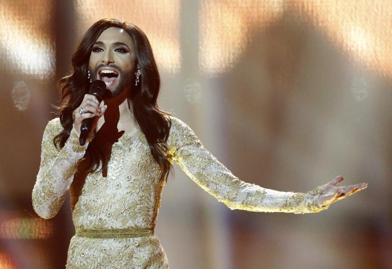 Singer Conchita Wurst representing Austria performs the song 'Rise Like a Phoenix' during the final of the Eurovision Song Contest in the B&W Halls in Copenhagen, Denmark, Saturday, May 10, 2014. Wurst won the competition. (AP Photo/Frank Augstein)