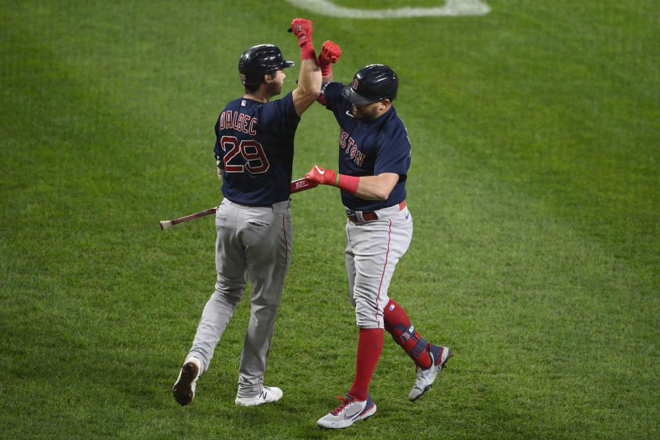 Boston Red Sox' Kyle Schwarber, right, celebrates his home run with Bobby Dalbec (29) during the second inning of a baseball game against the Baltimore Orioles, Tuesday, Sept. 28, 2021, in Baltimore. (AP Photo/Nick Wass)