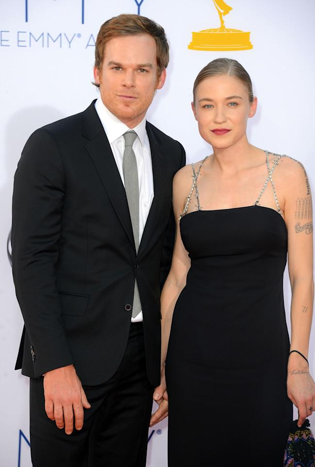 Michael C. Hall and Morgan Macgregor arrive at the 64th Primetime Emmy Awards at the Nokia Theatre in Los Angeles on September 23, 2012.