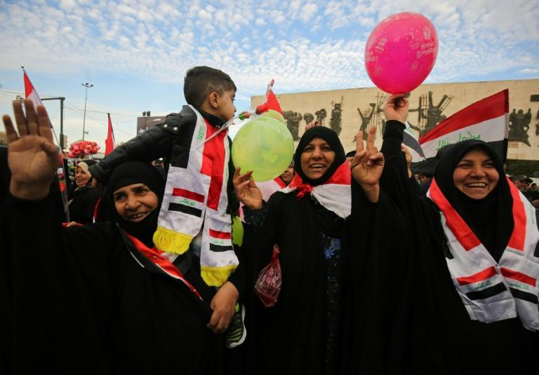 Iraqis gather in Baghdad's Tahrir Square to celebrate the declared end of the country's three-year war against the Islamic State group, in which its forces pushed the jihadists back with support from a US-led international coalition