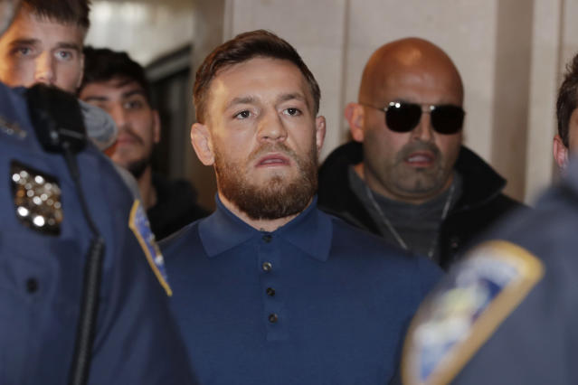 Conor McGregor is escorted by New York Court Police officers after a hearing at the Brooklyn Criminal Court, Friday, April 6, 2018 in New York. (AP)