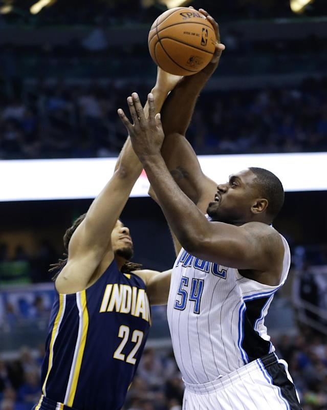 Orlando Magic's Jason Maxiell (54) attempts a shot over Indiana Pacers' Chris Copeland (22) during the first half of an NBA basketball game in Orlando, Fla., Wednesday, April 16, 2014. (AP Photo/John Raoux)