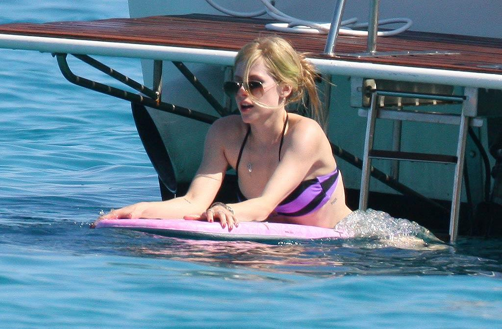 "Avril took her boogie board for one last whirl before getting back to business on Monday. ""New fragrance Wild Rose almost done,"" she tweeted. ""Cant wait 4 U to try. One of the ingredients is inspired by French dessert, Creme Brulee :) xo"" <a href=""http://www.infdaily.com"" target=""new"">INFDaily.com</a> - June 25, 2011"