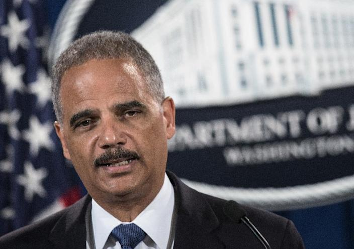 US Attorney General Eric Holder at the Department of Justice in Washington, DC, on September 4, 2014 (AFP Photo/Brendan Smialowski)