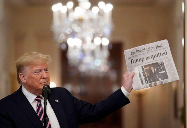 PHOTO: President Donald Trump holds a copy of The Washington Post as he speaks in the East Room of the White House one day after the Senate acquitted him on two articles of impeachment, Feb. 6, 2020, in Washington, DC. (Drew Angerer/Getty Images, FILE)