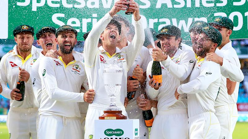 Tim Paine, pictured here celebrating with the Ashes urn.