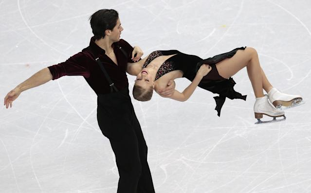 Kaitlyn Weaver and Andrew Poje of Canada compete in the ice dance free dance figure skating finals at the Iceberg Skating Palace during the 2014 Winter Olympics, Monday, Feb. 17, 2014, in Sochi, Russia